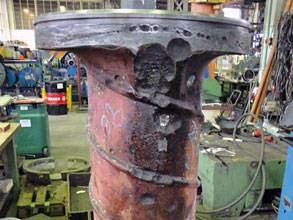 Damaged bow thruster casing of a cargo ship