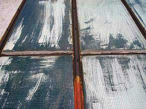 Corroded steel frame and degraded rubber seal on skylights