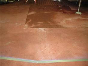 Old dairy floor subject to hot cleaning chemicals