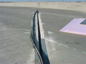 Steel armored expansion joint on a busy highway bridge